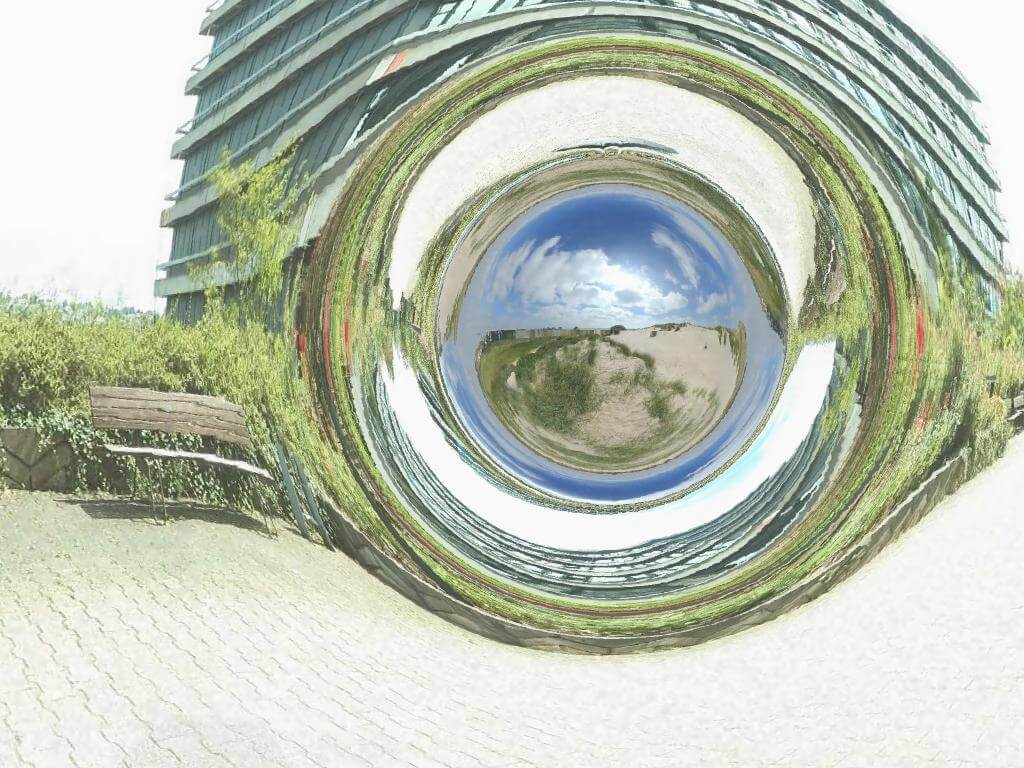 Image of a simulated traversable wormhole that connects the square in front of the physical institutes of Tübingen University with the sand dunes near Boulogne sur Mer in the north of France. By CorvinZahn.
